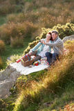 Couple on country picnic. Taking a picture Royalty Free Stock Image