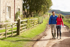 Couple on country walk Stock Photography