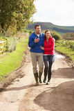 Couple on country walk Stock Images