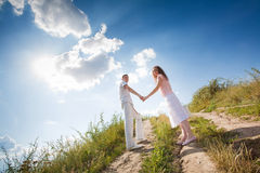 Couple on country walk holding hands Stock Photos