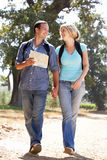 Couple on a country walk using a map. Smiling Stock Photo