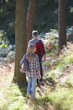 Couple On Country Walk Through Woodland Stock Photos