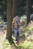 Couple On Country Walk Through Woodland Stock Image
