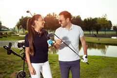 Couple at the course playing golf and looking happy - Image stock images