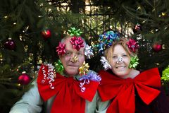 Couple with bows under Christmas tree Royalty Free Stock Photo