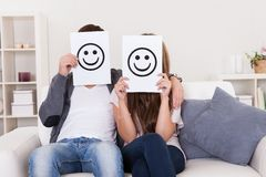 Couple covered faces Royalty Free Stock Photo