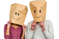 Couple covering their faces with paper bag Stock Photography