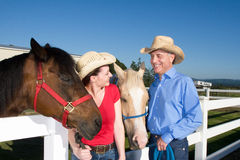 Couple in Cowboy Hats With Horses - Horizontal Stock Image