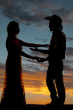 Couple cowboy reach to each other silhouette Stock Photo
