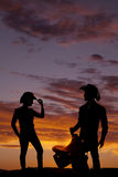 Couple cowboy silhouette facing Royalty Free Stock Image