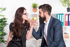 Couple coworkers relax lunch break. Share lunch with with colleague. Flirting colleagues. Bearded man and attractive. Couple coworkers relax lunch break. Share stock photos