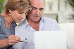 Couple with credit card. Shopping on the internet stock photos