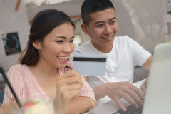 Couple with credit card and laptop Stock Image