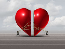Couple In Crisis. And relationship problem concept as a man and woman pulling apart a red valentine heart as a divorce or separation metaphor with 3D Royalty Free Stock Images