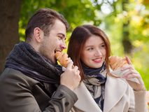 Couple with croissants stock photography