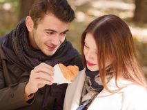 Couple and croissants royalty free stock images