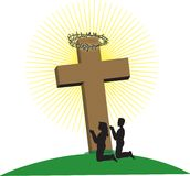 Couple at Cross. Man and Woman kneeling at the foot of the cross Royalty Free Stock Photo