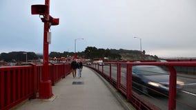 Couple crossing the bridge. stock video footage