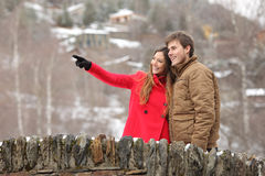 Couple crossing a bridge in winter holidays Stock Photos