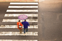 Couple on the crosswalk Stock Photos