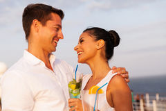 Couple cruise cocktails. Romantic young couple on cruise having cocktails Royalty Free Stock Photography