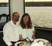A Couple Cuddles on a Dining Cruise Royalty Free Stock Photography