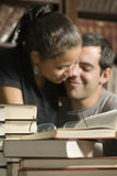 Couple Cuddles in Library - Vertical Royalty Free Stock Photography