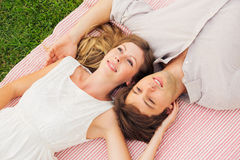 Couple cuddling and flirting in a park Stock Images