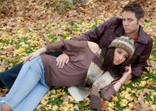 Couple Cuddling in Grass Royalty Free Stock Images