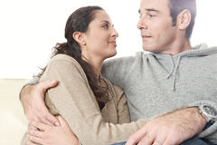 Couple Cuddling at home Stock Images