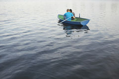 Couple Cuddling In Rowboat At Lake Royalty Free Stock Photography