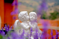 Couple cupid statue kissing Stock Photos