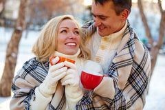 Couple with cups Royalty Free Stock Photos
