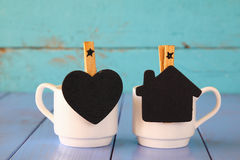 Couple of cups of coffee and little chalkboards Royalty Free Stock Image