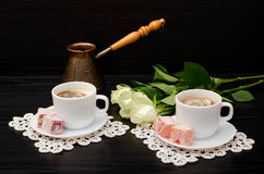 A couple cups of coffee with milk, Cezve, oriental sweets Royalty Free Stock Image