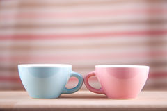 Couple cups of soft background symbol for men and women. Love dialogue royalty free stock images