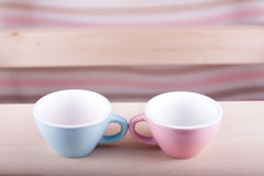 Couple cups of soft background symbol for men and women. Love dialogue royalty free stock photography