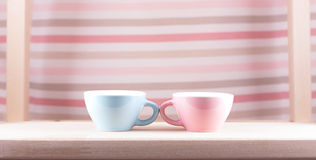 Couple cups of soft background symbol for men and women. Love dialogue stock image