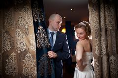 Couple in curtains Royalty Free Stock Photos