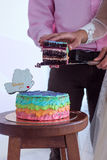 Couple cut the cake. The couple cut the cake and keeps it on weight Royalty Free Stock Image