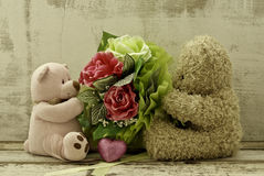 Couple of cute  bears holding roses bouquet Stock Photo