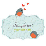 Couple cute birds sitting on frame. Couple cute love birds/with bird tracks and hearts Royalty Free Stock Images