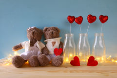 Couple of cute teddy bears holding a heart Royalty Free Stock Photo