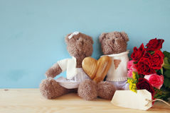 Couple of cute teddy bears holding a heart Stock Photo