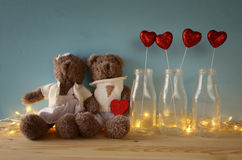 Couple of cute teddy bears holding a heart Royalty Free Stock Image