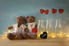 Couple of cute teddy bears holding a heart Stock Photos