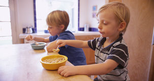 Couple of cute young boys eating breakfast together Stock Image