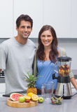 Couple cutting fruits Stock Photography