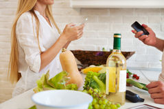 Couple cutting vegetables at the kitchen. Couple preparing dinin Stock Photo