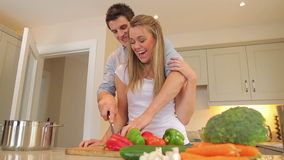Couple cutting vegetables together Royalty Free Stock Image